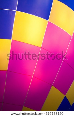 Multi colored hot air balloon view from inside - stock photo