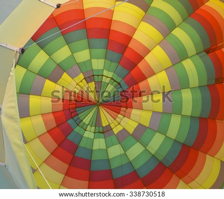 Multi-colored interior of a hot air balloon in flight - stock photo