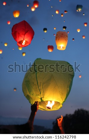 Multi-colored lanterns in the evening sky
