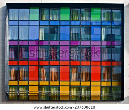 Multi-colored modern apartment building windows - stock photo