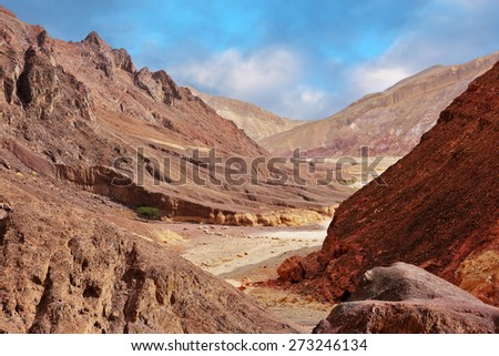 "Multi-colored mountains of Eilat, Israel. Warm day in January. The road to the ""Pillars of Amram"" - stock photo"