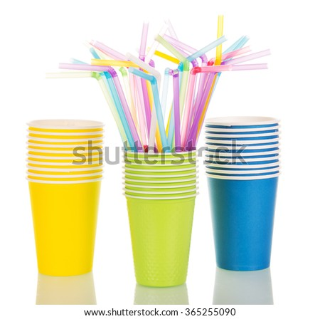Multi-colored paper cups and cocktail straws isolated on white background - stock photo