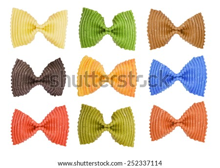 Multi colored pasta on a white background - stock photo