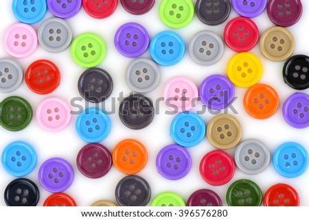 multi-colored plastic buttons on a white background.