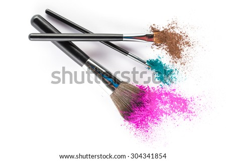Multi Colored Powder Eyeshadow on a Brush, fashion beauty  tool blusher - stock photo
