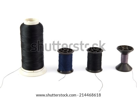 multi-colored r threads for sewing on white background