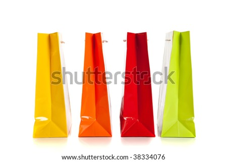 multi colored shopping bags in a row on a white background - stock photo