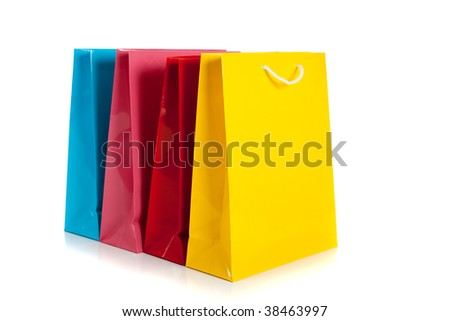 multi colored shopping bags in a row on a white background