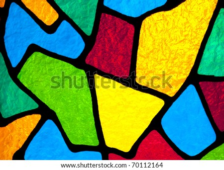 Multi colored stained glass inside a church that is backlit by the sun light. - stock photo