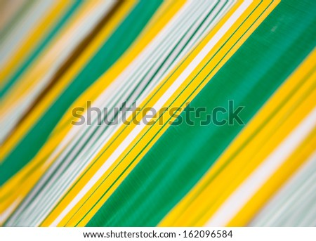 multi-colored striped fabric as a background - stock photo