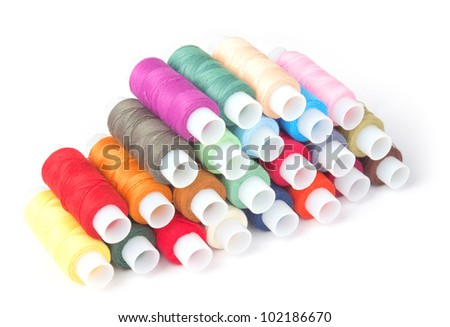 Multi-colored threads on a white background - stock photo