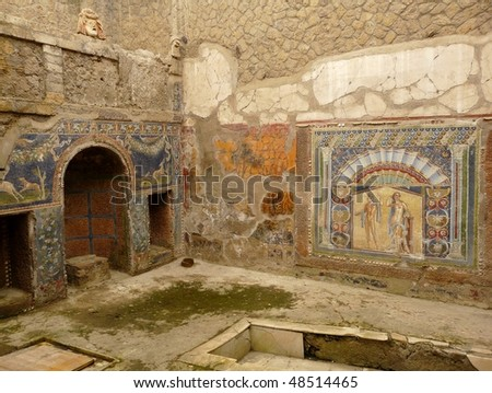 Multi-colored wall mosaics at the ancient Roman city of Herculaneum, which was destroyed and buried by mud and ash during the eruption of Mount Vesuvius in 79 AD - stock photo