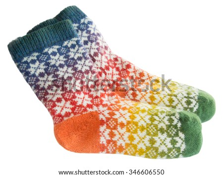 Multi-colored woolen socks on a white background - stock photo