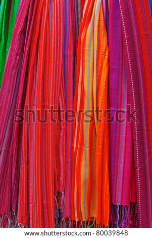Multi-colors scarfs on the market - stock photo