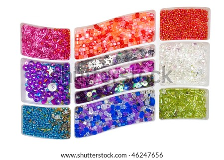 Multi-coloured beads of the different form in boxes - stock photo