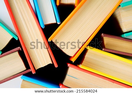 Multi-coloured books from above. The Close up. - stock photo