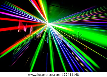 Multi coloured lasers in nightclub party - stock photo
