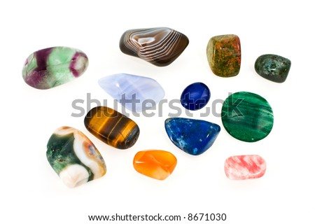 Multi-coloured ornamental stones on a white background - stock photo