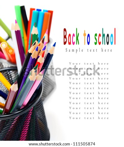Multi-coloured pencils and felt-tip pens in baskets. - stock photo