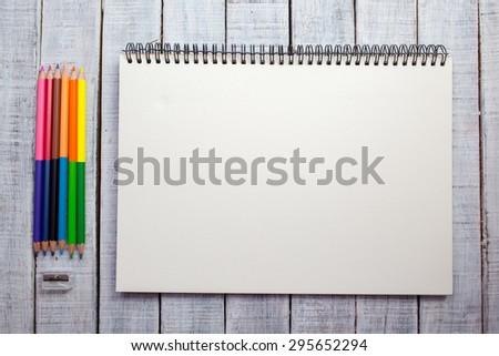 Multi-coloured pencils and writing-books - stock photo