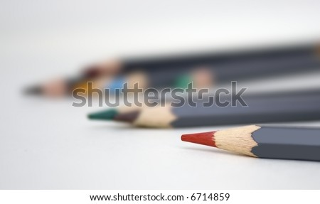 Multi-Coloured Pencils with Shallow Depth of Field with Focus on Tip of Red pencil. - stock photo