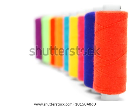 Multi-coloured threads. On a white background. - stock photo