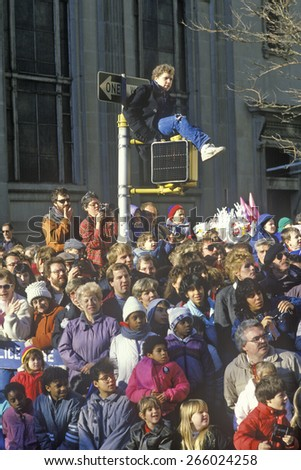 Multi-cultural crowd at traditional Thanksgiving day Macy's Parade, New York, NY - stock photo