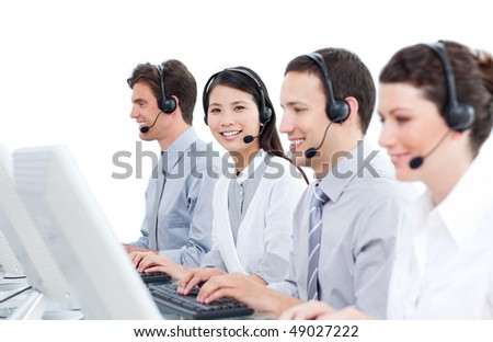 Multi-cultural customer service agents working in a call center against a white background
