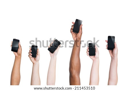 Multi-Ethnic Arms Raising Smartphones and One Standing Out - stock photo