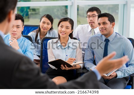 Multi-ethnic audience at the business conference - stock photo