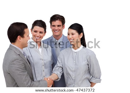 Multi-ethnic business partners shaking hands against a white background