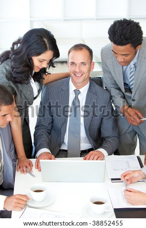 Multi-ethnic business people discussing in office a plan - stock photo