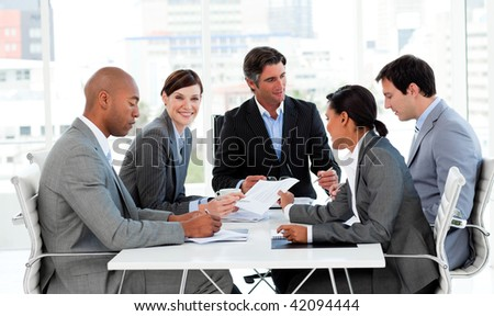 Multi-ethnic business people disscussing a budget plan in a meeting - stock photo