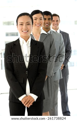 Multi ethnic business people standing in a row. - stock photo