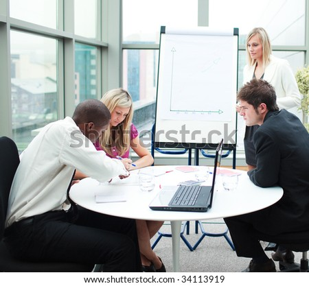 Multi-ethnic business people working together in a meeting - stock photo