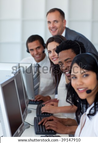 Multi-ethnic business team and manager working in a call center with a manager