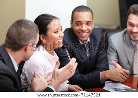 Multi ethnic business team at a meeting. Interacting. Focus on woman - stock photo
