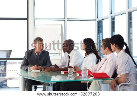 Multi-ethnic business team interacting in a meeting - stock photo