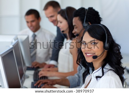 Multi-ethnic business team working in a call center with a manager