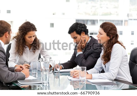 Multi ethnic business team working together during a meeting - stock photo