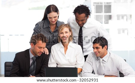 Multi-ethnic business team working with a laptop in an office