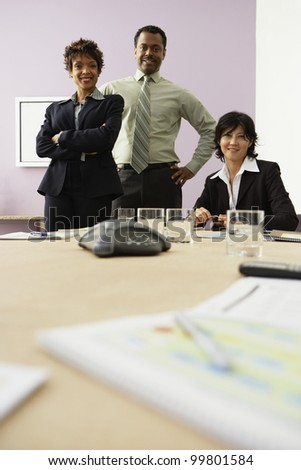 Multi-ethnic businesspeople at conference table - stock photo