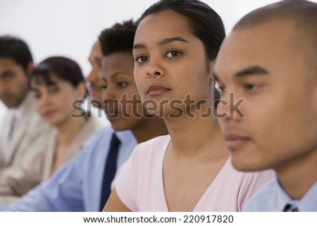Multi-ethnic businesspeople at meeting - stock photo