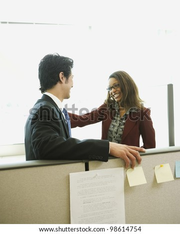 Multi-ethnic businesspeople smiling at each other - stock photo