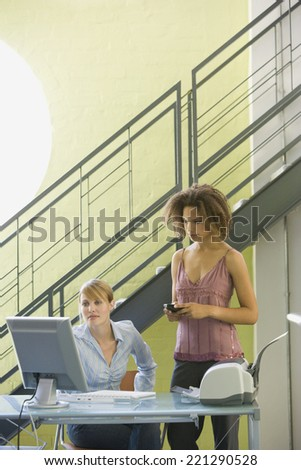 Multi-ethnic businesswomen looking at computer