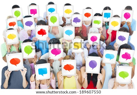 "Multi-ethnic casual people holding the tablet's ""speech bubble"" screen - stock photo"