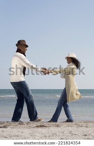 Multi-ethnic couple dancing at beach