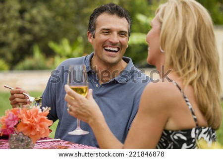 Multi-ethnic couple laughing - stock photo