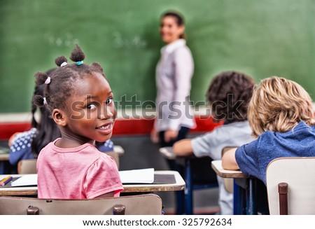 Multi ethnic elementary classroom. - stock photo