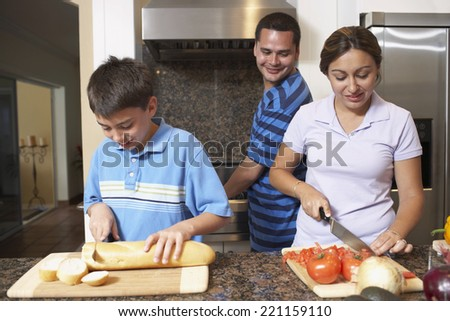 Multi-ethnic family preparing food - stock photo